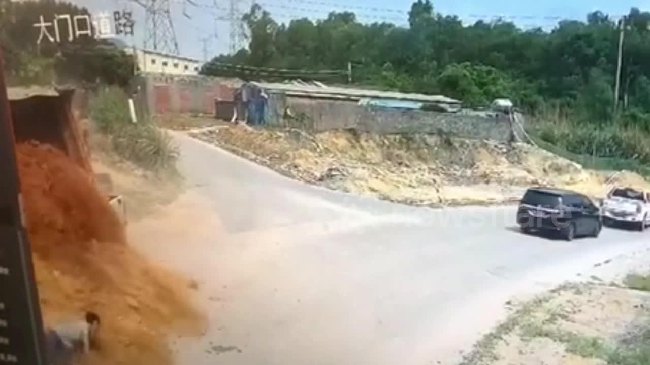 Chinese pedestrian narrowly escapes being buried after truck transporting mud crashes
