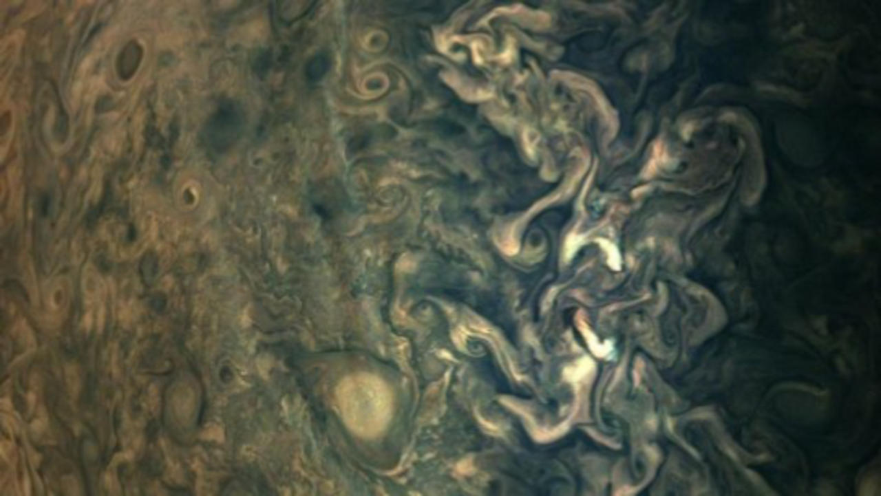 Check Out This Strange Haze Streak Floating Above Jupiter's Cloud Tops