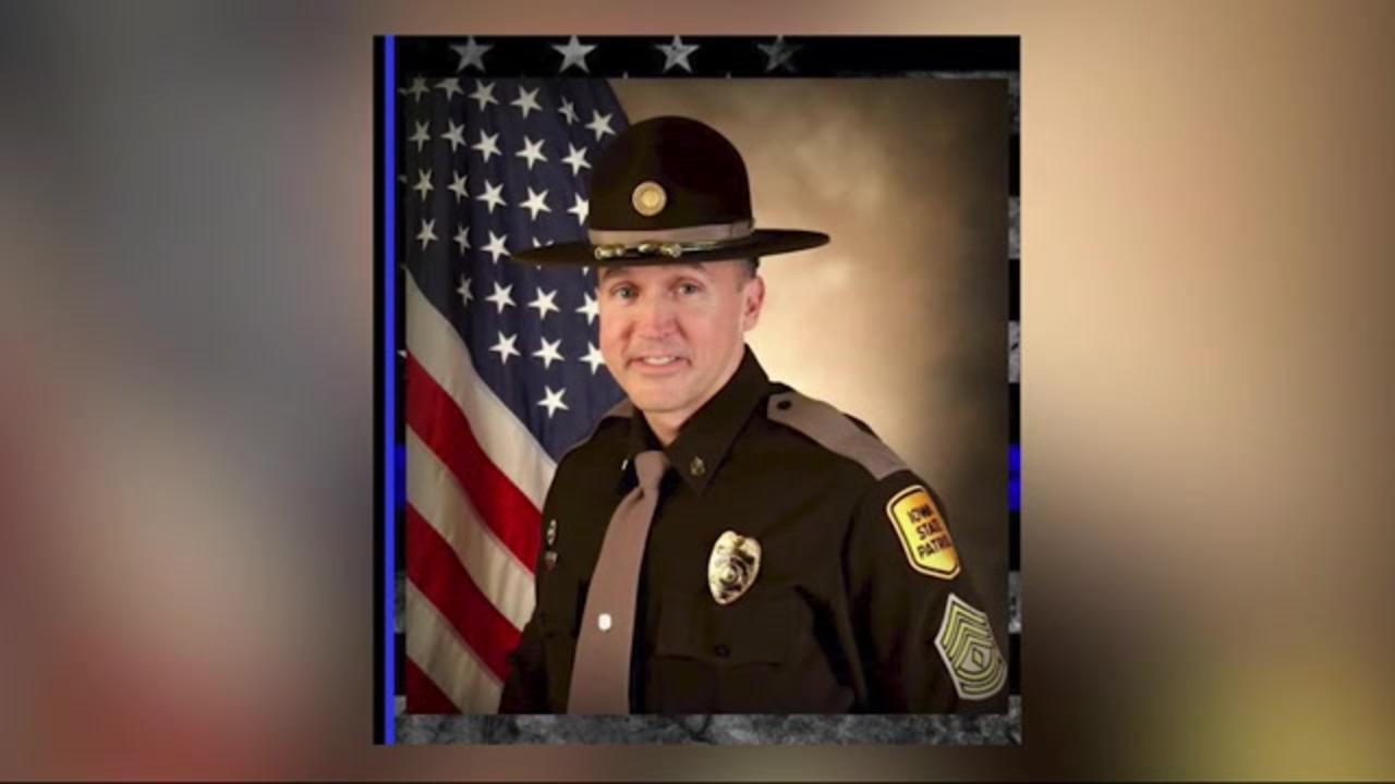 Procession returns Iowa officer killed during standoff to his hometown