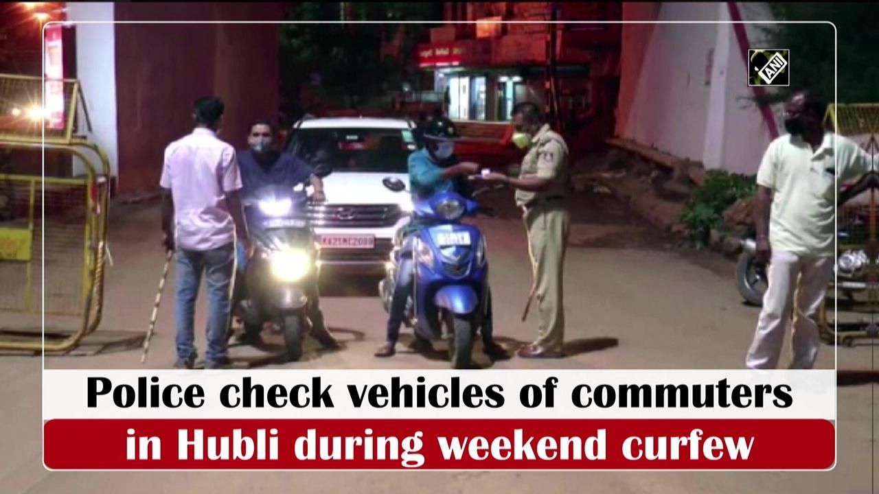 Police check vehicles of commuters in Hubli during weekend curfew