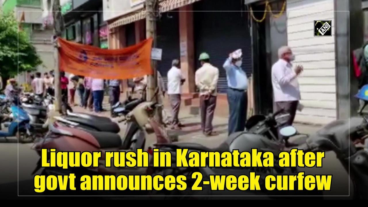 Liquor rush in Karnataka after govt announces 2-week curfew