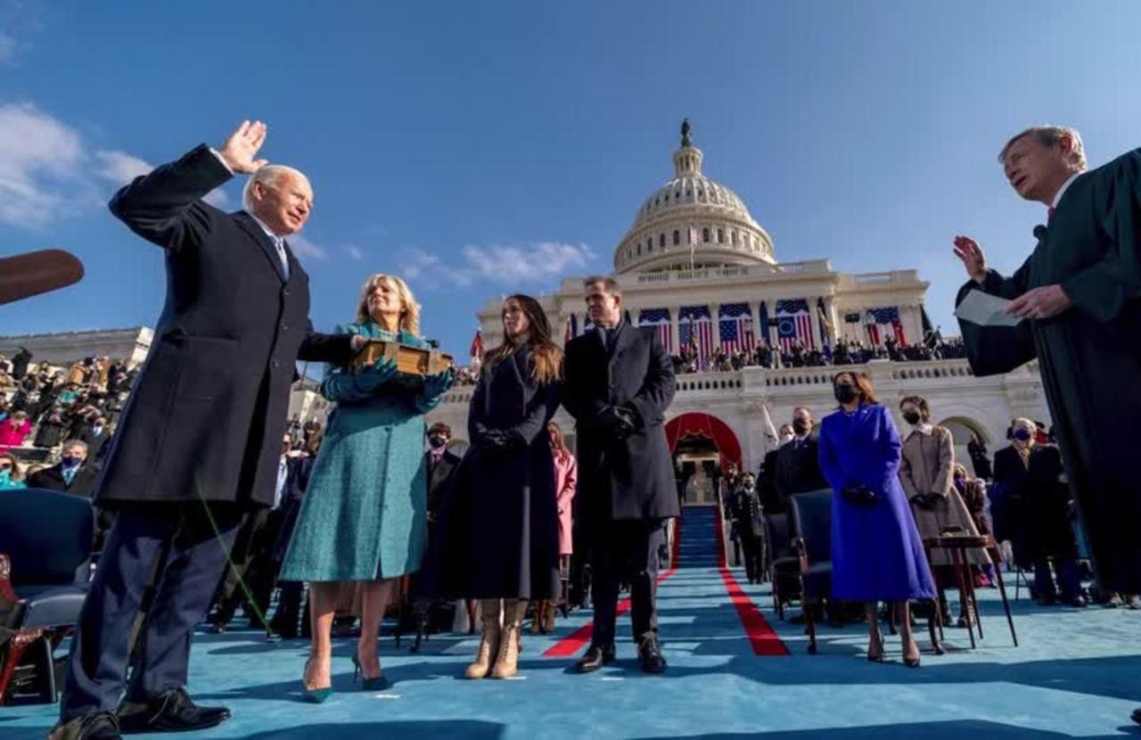 Biden's first 100 days: shots, checks, dogs