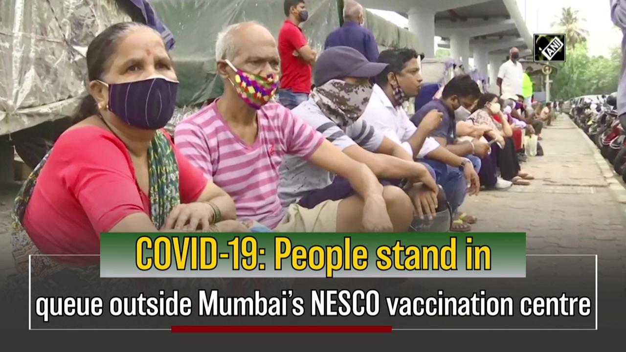 COVID-19: People stand in queue outside Mumbai's NESCO vaccination centre