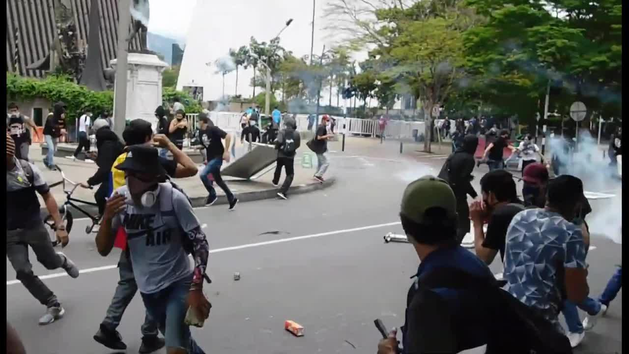 Intense scene as police and protesters in Colombia clash amid controversial tax reform