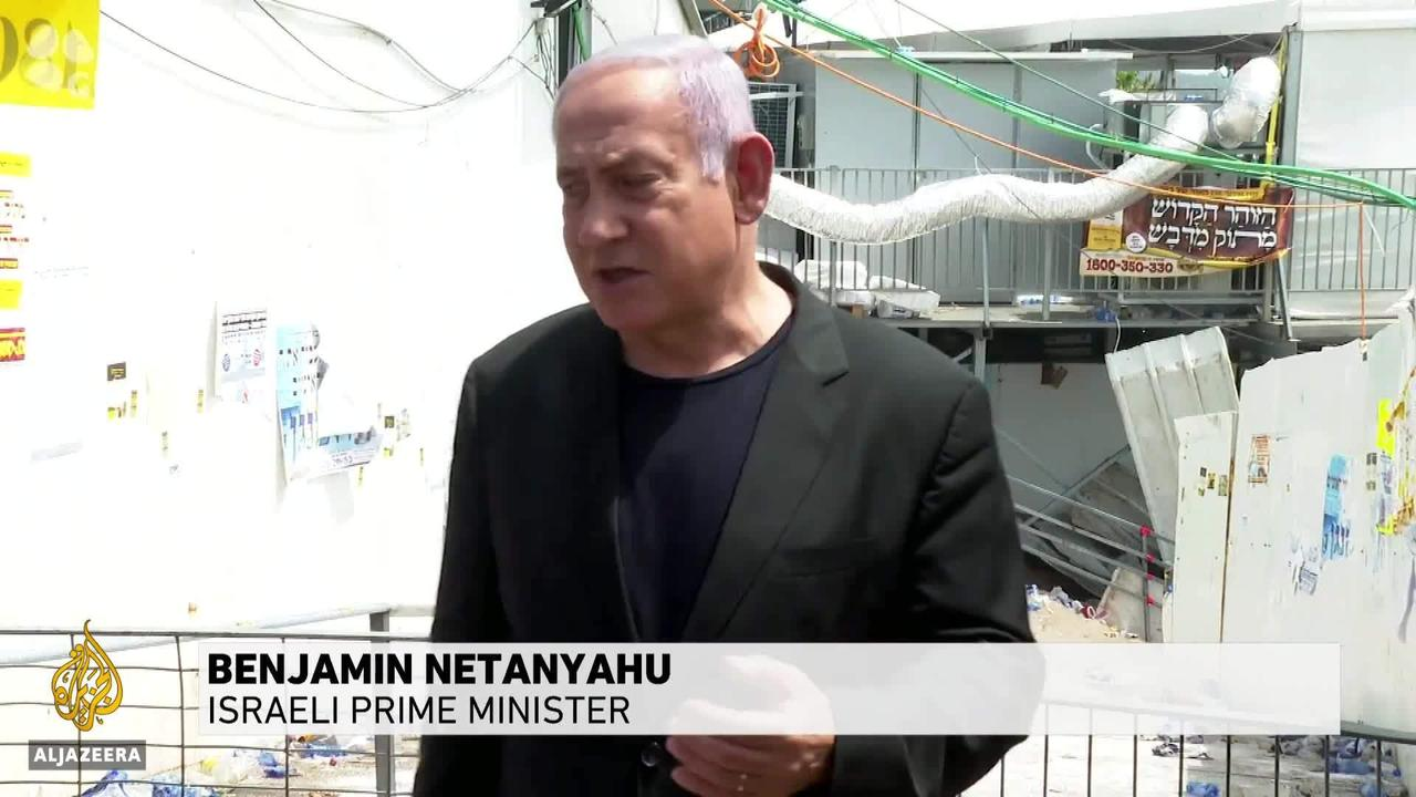 Israel's Netanyahu booed by bereaved protesters at stampede site