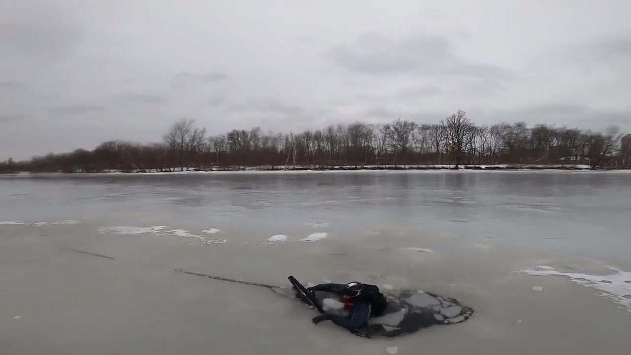 Men Fall Through Ice While Biking on Frozen River