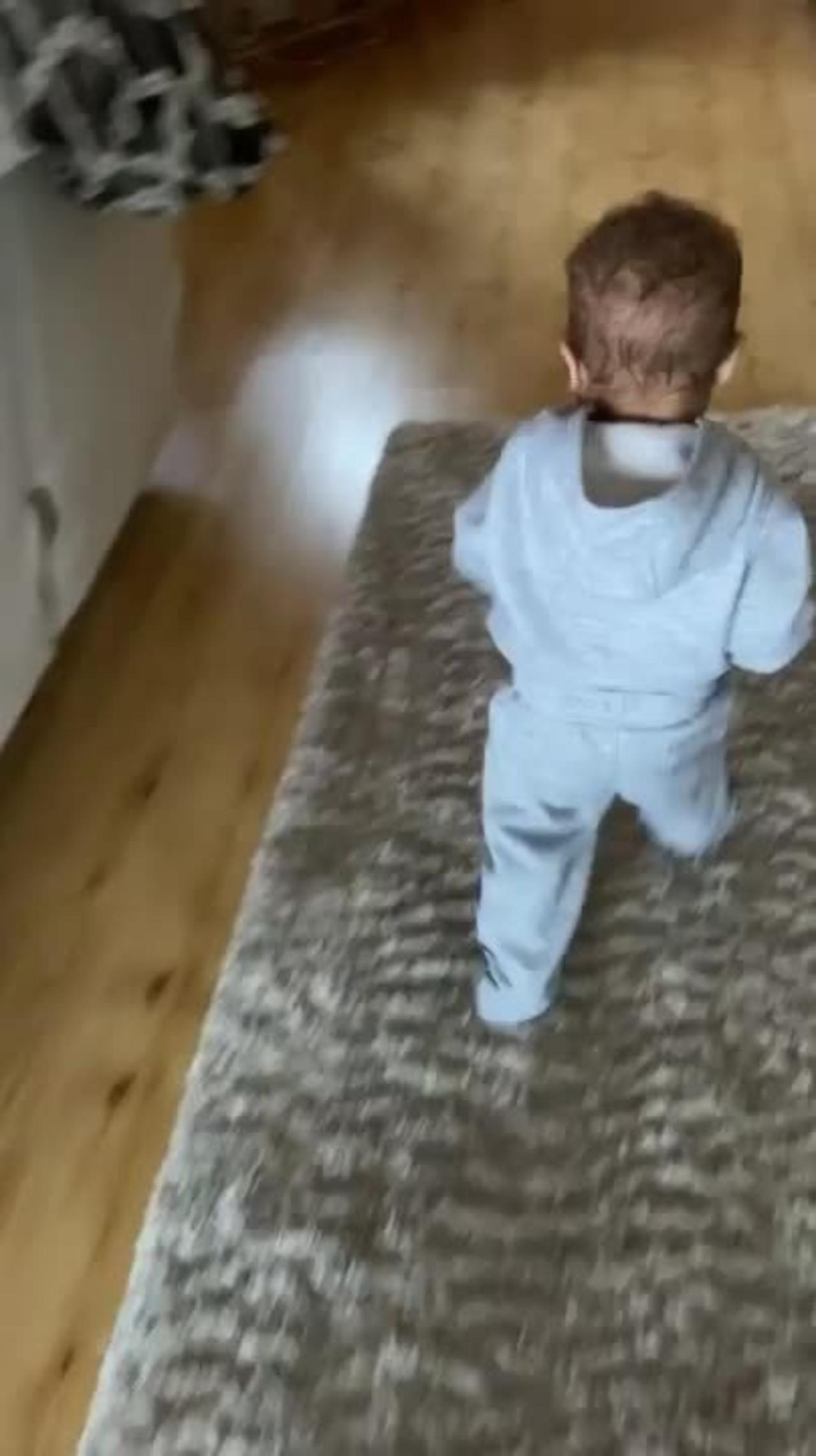 Toddler Slips and Falls Over Backwards While Running Around Holding Football