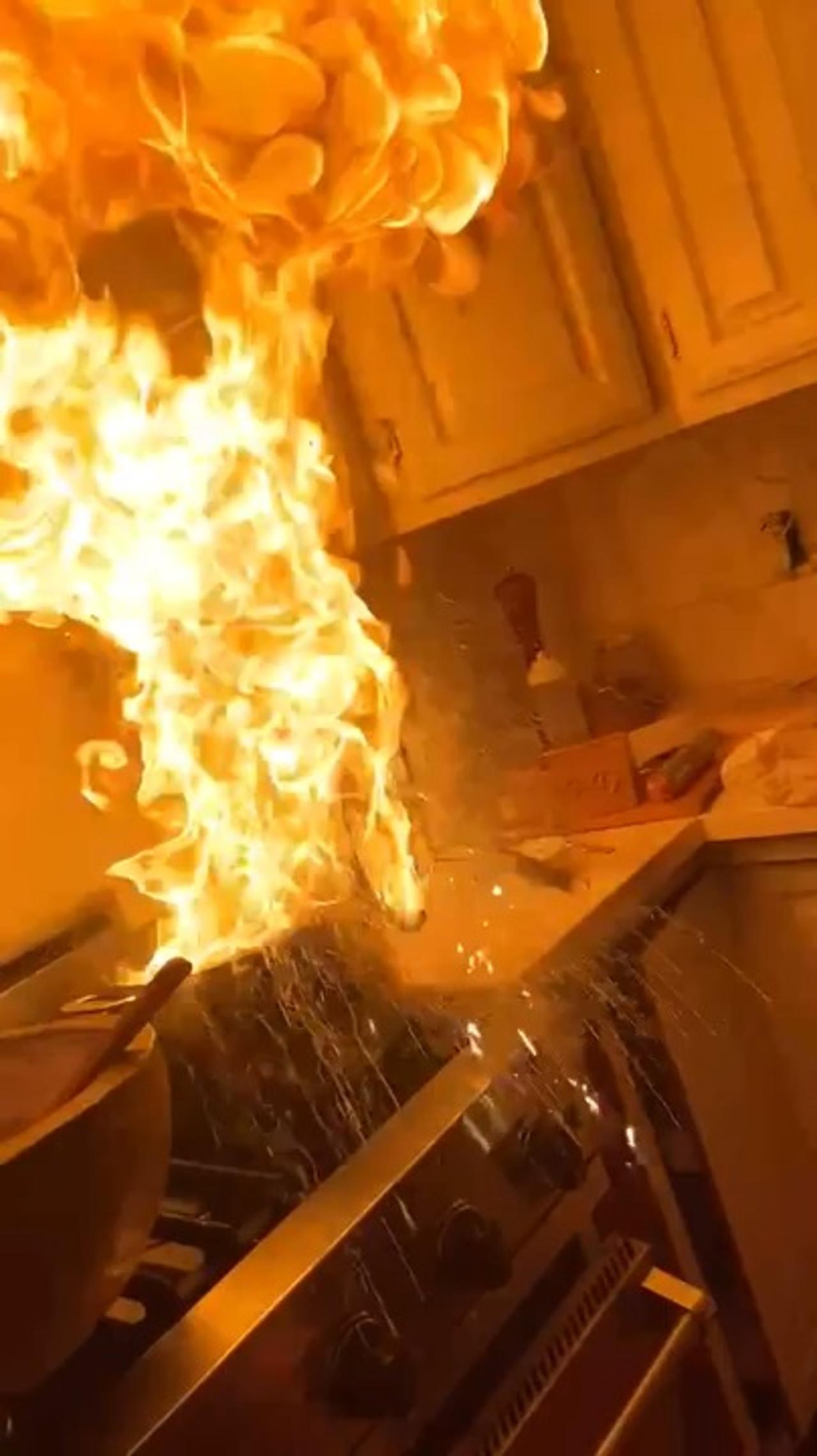 Girl Tries to Douse Fire in Pan With Cloth and Screams as she Accidentally Aggravates it