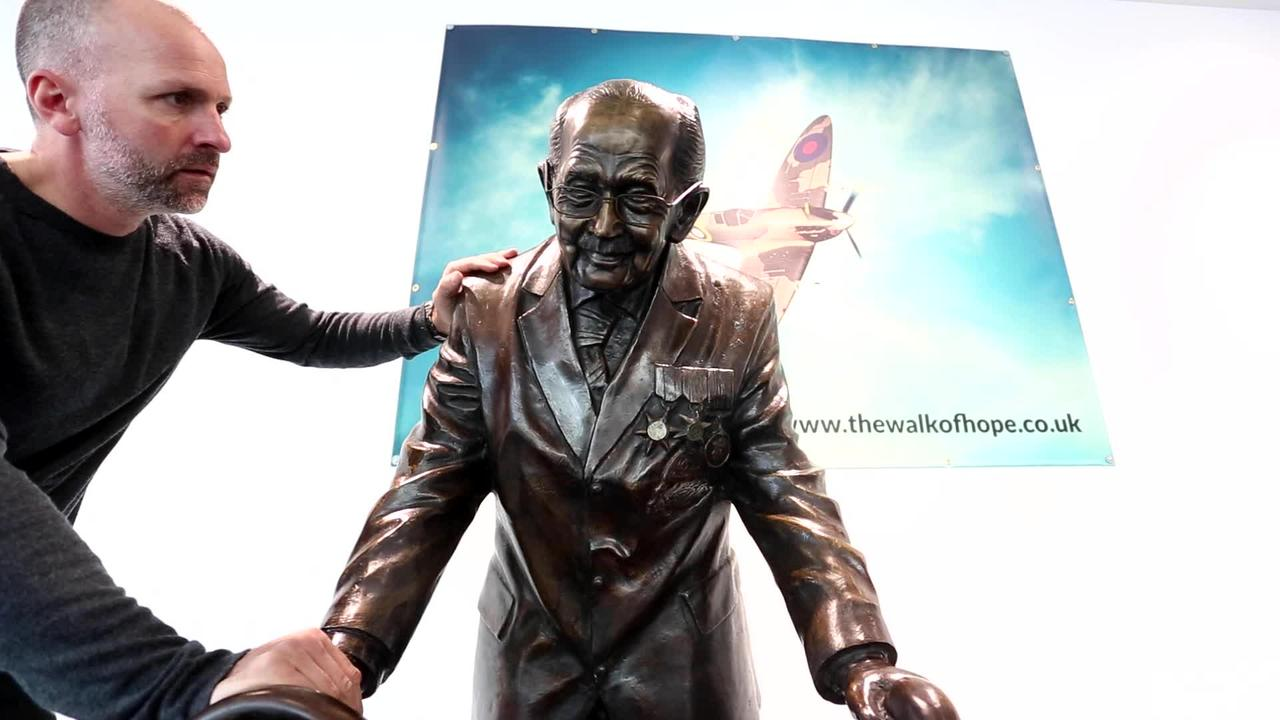 Artist reveals his life-size statue of Captain Sir Tom Moore at a shopping centre in Leeds