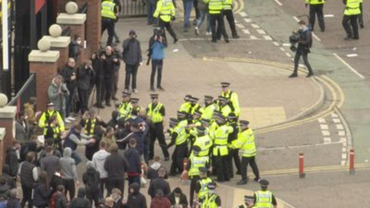 Police face off against Man Utd protesters