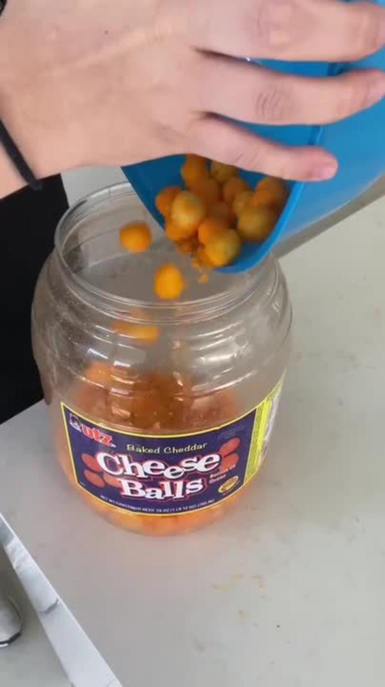 Guy Pranks Friend by Cutting Bottom of Cheese Balls' Container