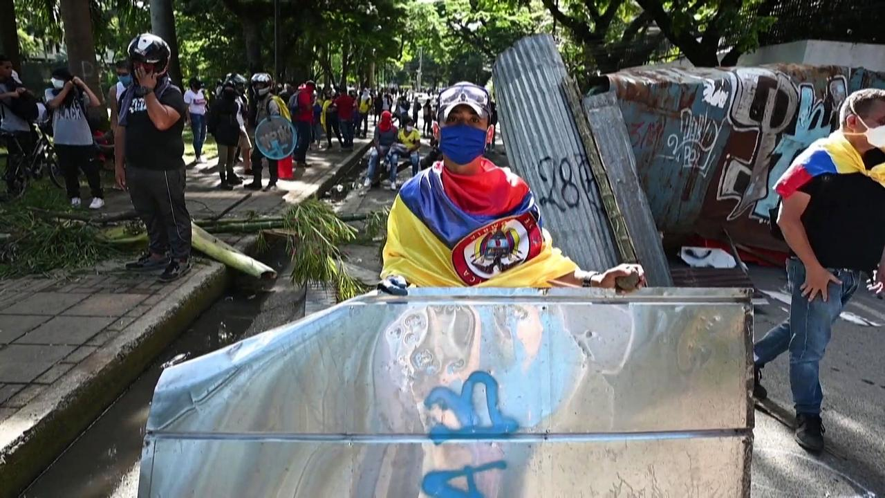 Police and protesters clash over Colombia tax reform