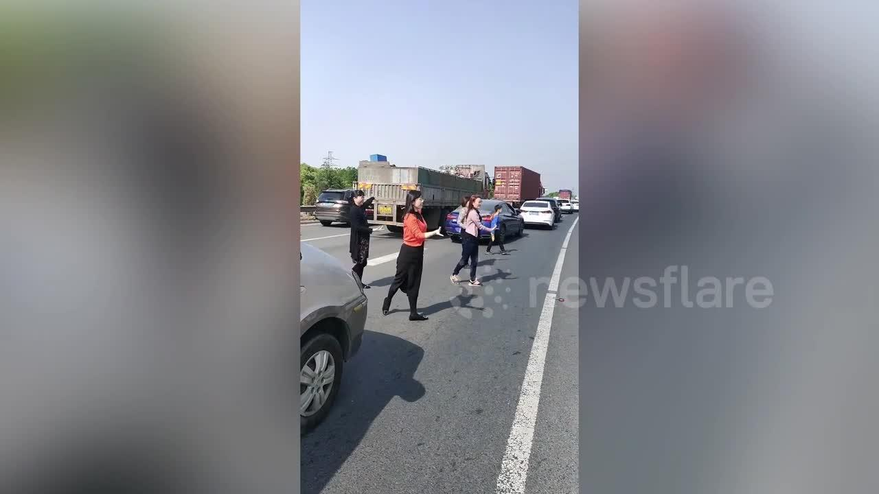 Motorists begin dancing to pass time as traffic jam builds on expressway in China