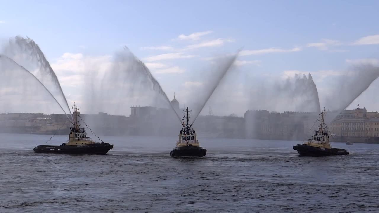 Tug boats perform 'waltz' to open tourist season in St Petersburg in Russia