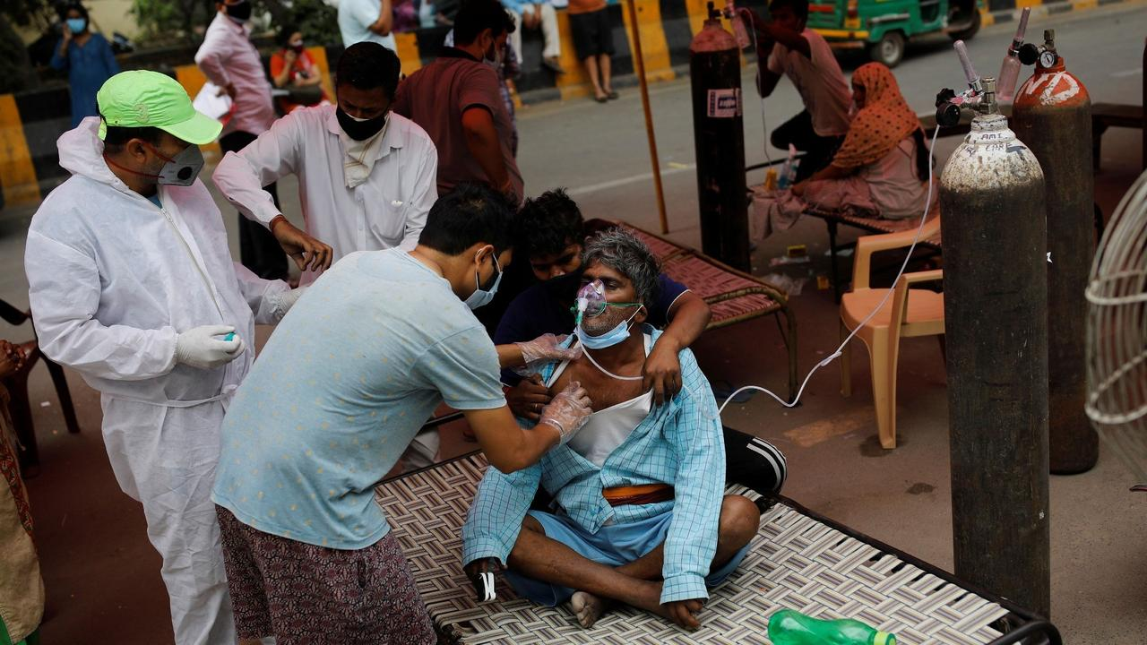 India tops 20m COVID cases, 'horrible' weeks ahead