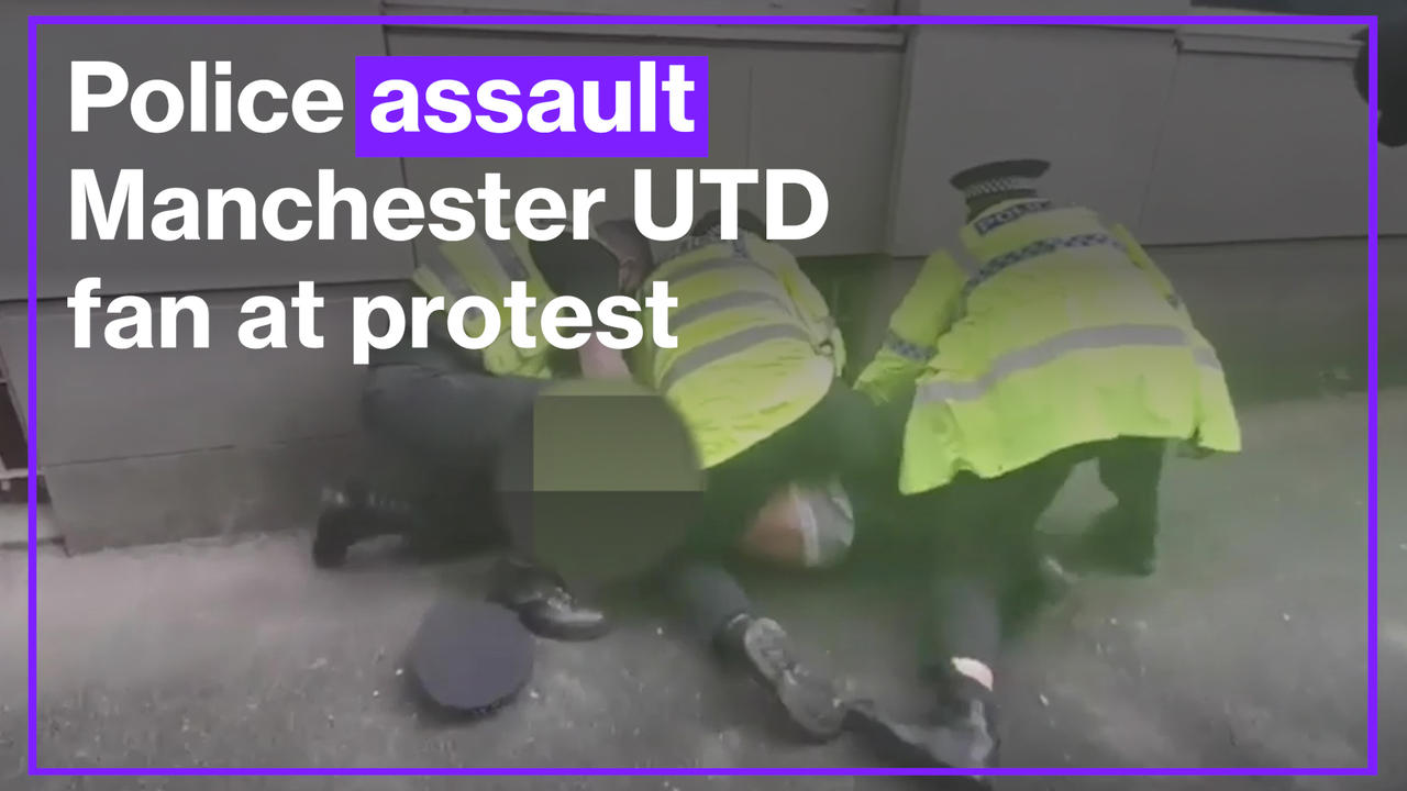 Police officer appears to punch Man Utd fan on ground in eyewitness footage