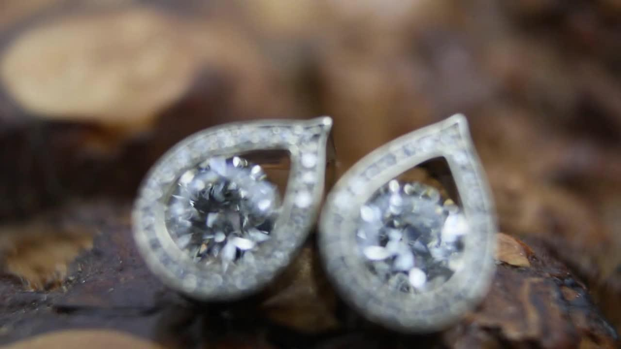 Intricate process as jeweller crafts earrings using recycled diamonds and gold