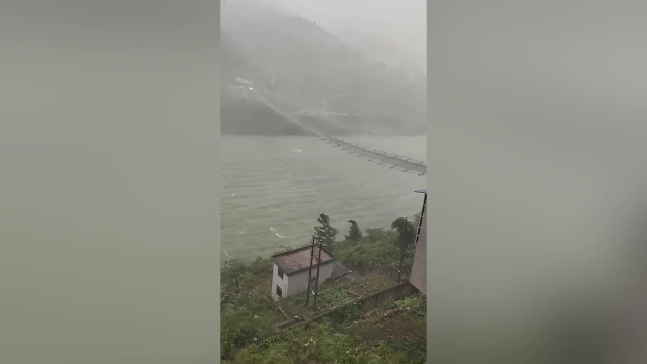 Terrifying scene as cable bridge violently swings as strong winds batter southern China