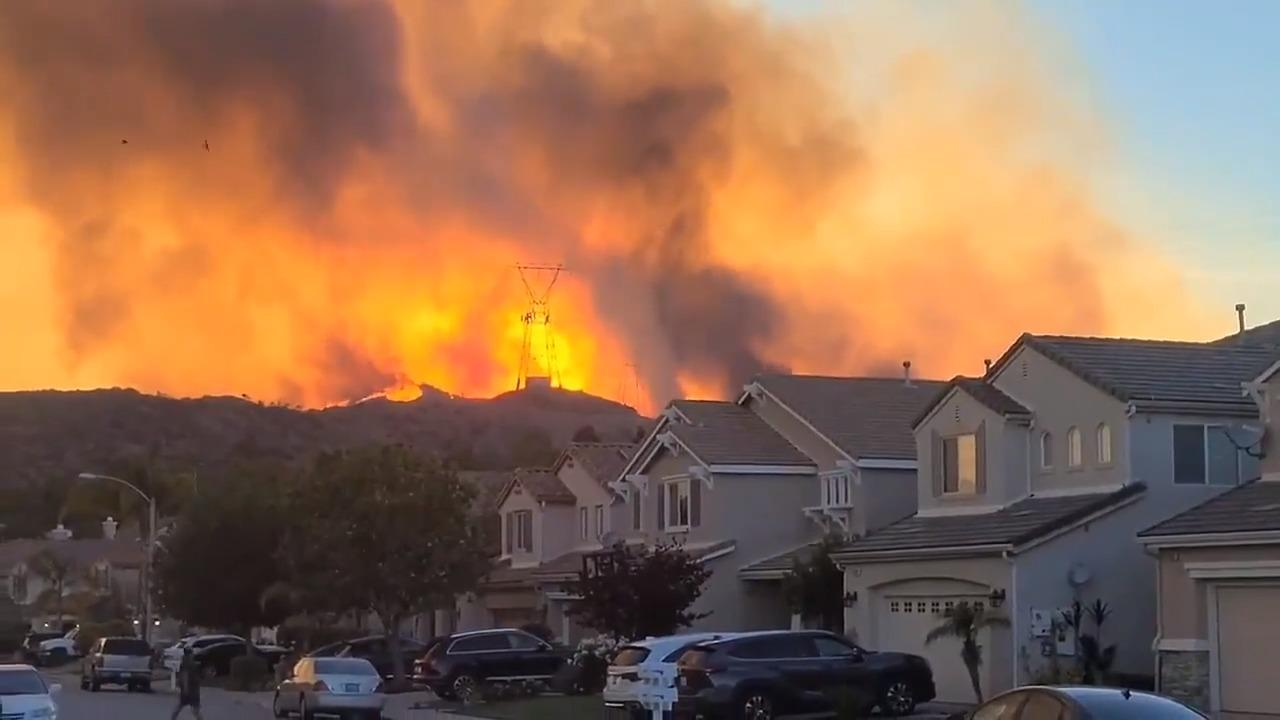 Smoke Engulfs Orange Sky As Wildfire Spreads Downhill in U.S. Neighborhood