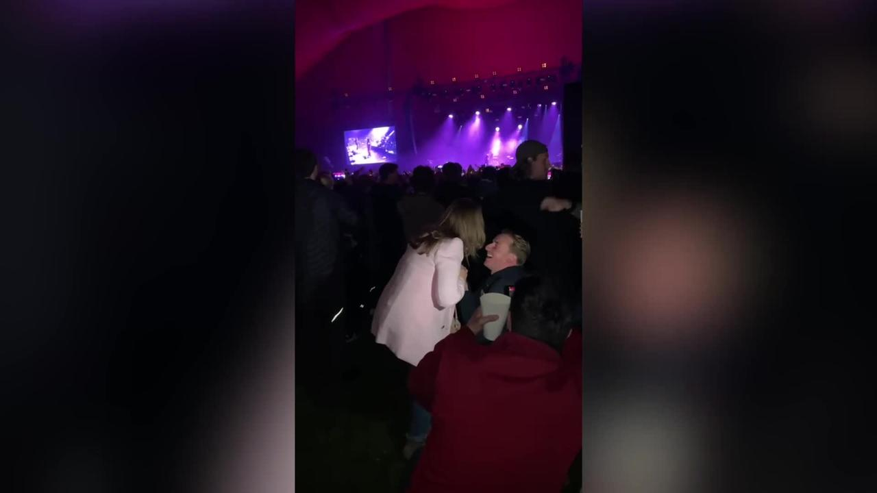 Music lover proposed to his girlfriend while watching their favourite band