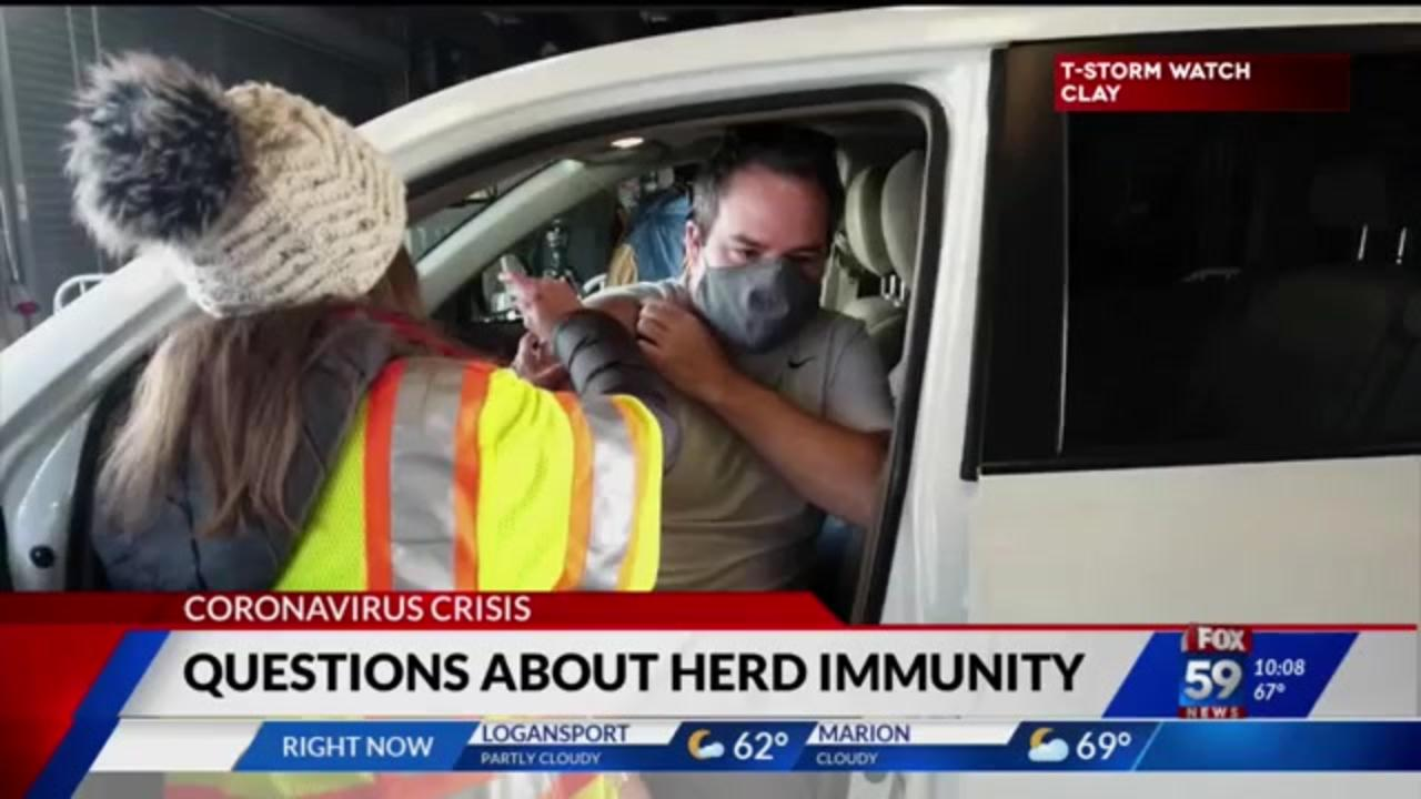 Health experts urge people to consider their own communities instead of focusing on herd immunity