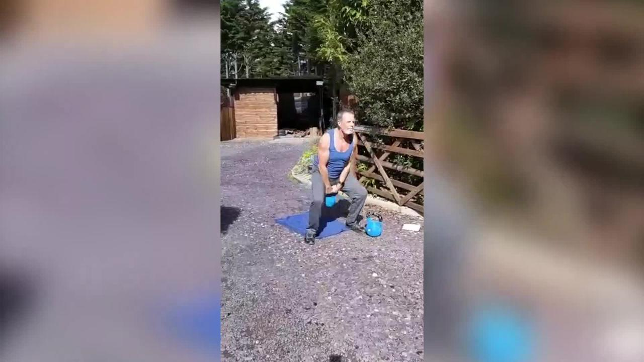 A 64-year-old grandfather awaiting a hip replacement completes 10,000 kettle bell swings for new record