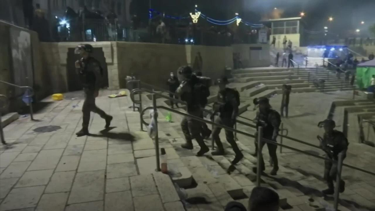 Israeli police and Palestinian protesters clash during holiest night of Ramadan