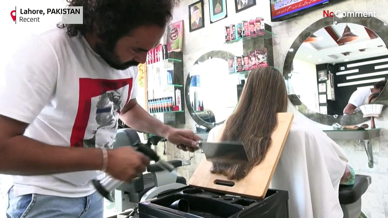 Pakistan barber offers hair-raising cuts with cleavers and blowtorches