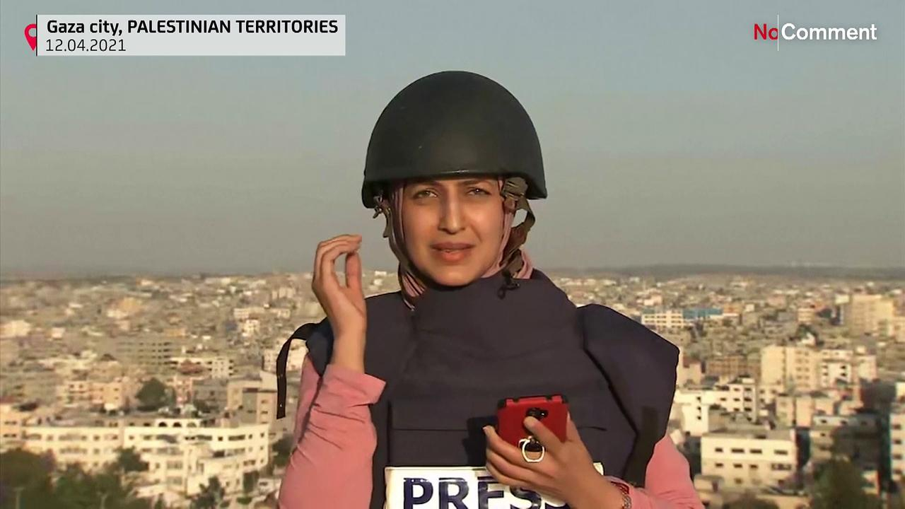 Gaza journalist reports live when building is hit