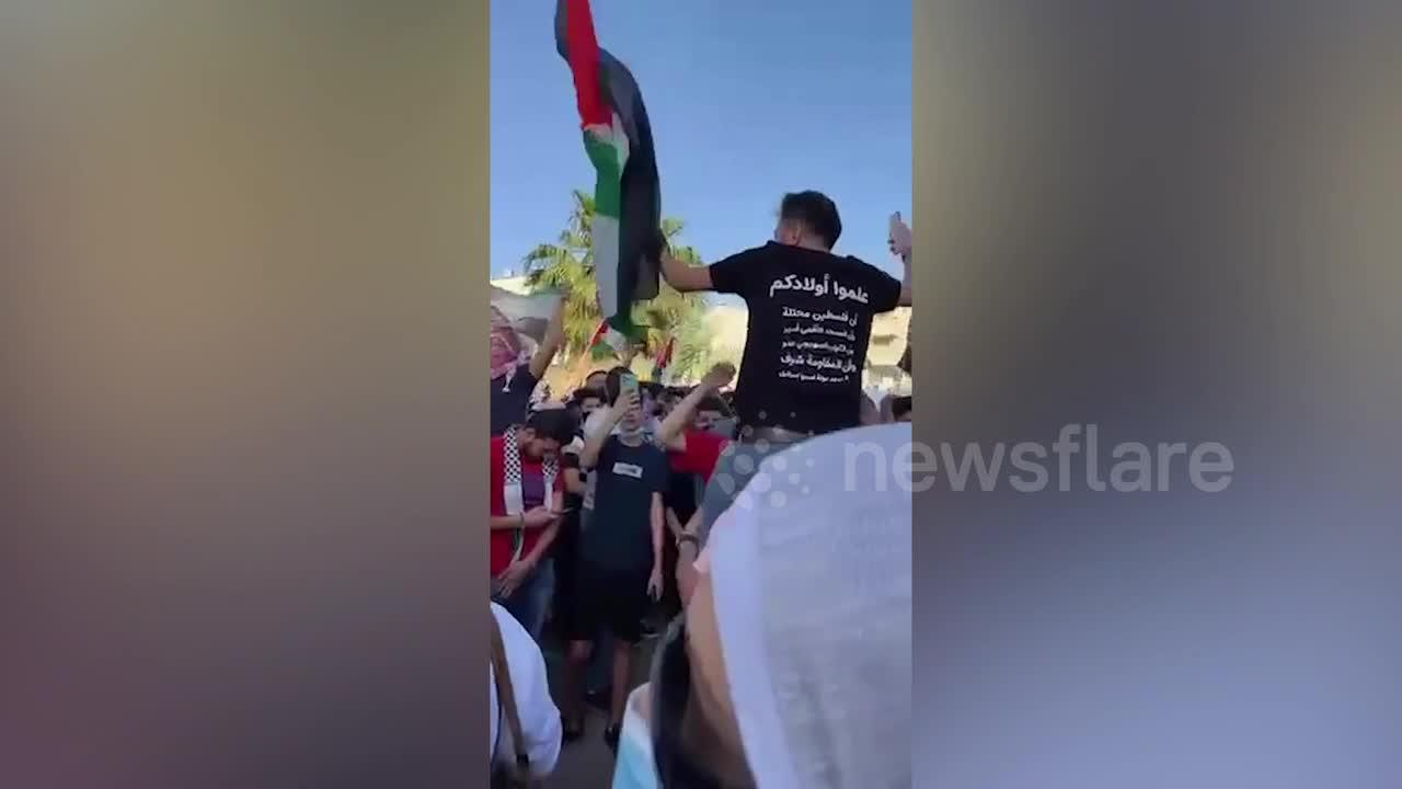 Palestinian supporters protest in Jordan amid rocket strikes with Israel