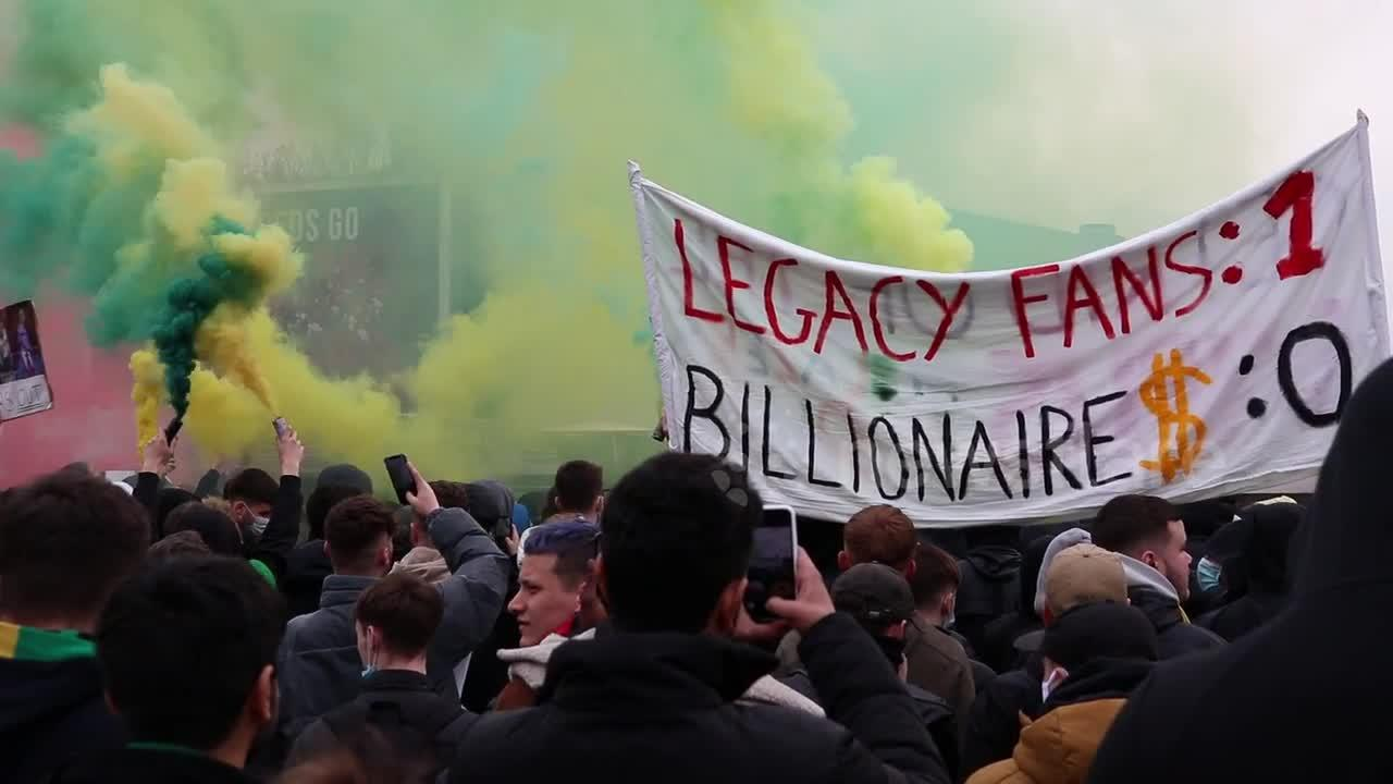 Manchester United fans protest features flares, angst, and arrests