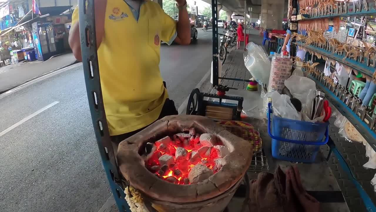 Street food stalls sell grilled baby stingray in Thailand