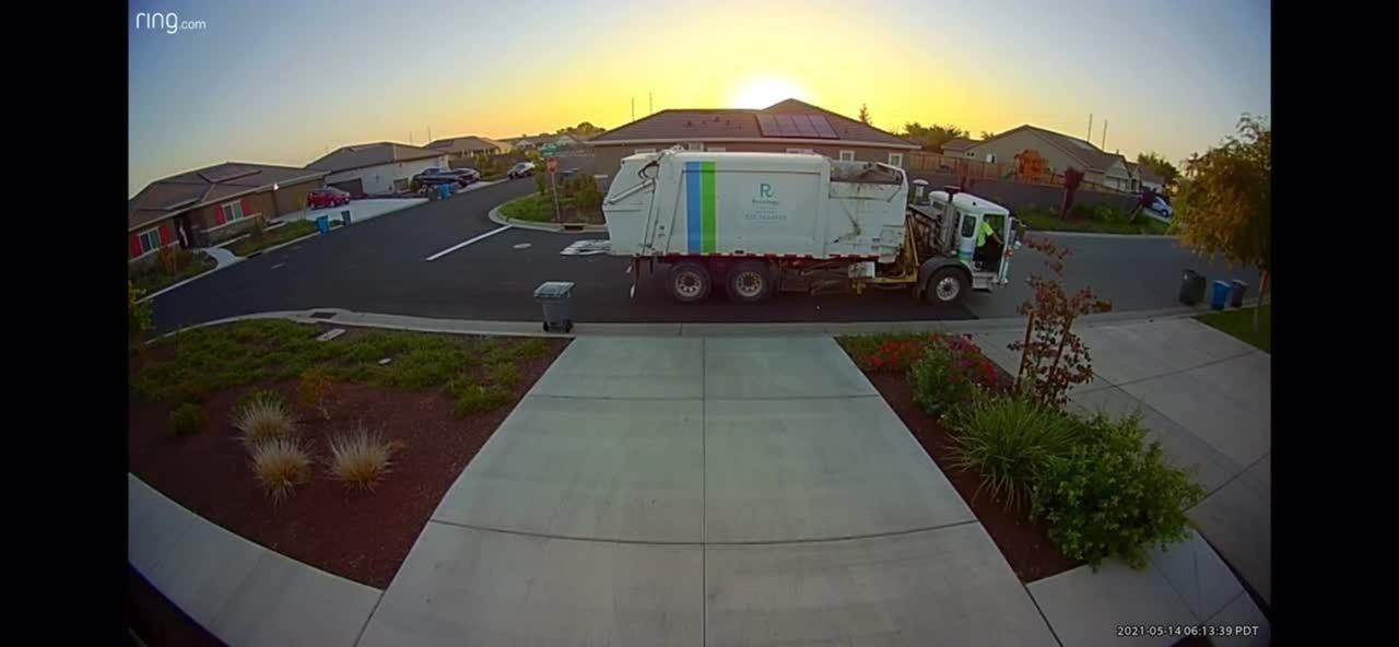 Garbage Truck Uses Robot To Dump Garbage Bin Inside Its Dumpster