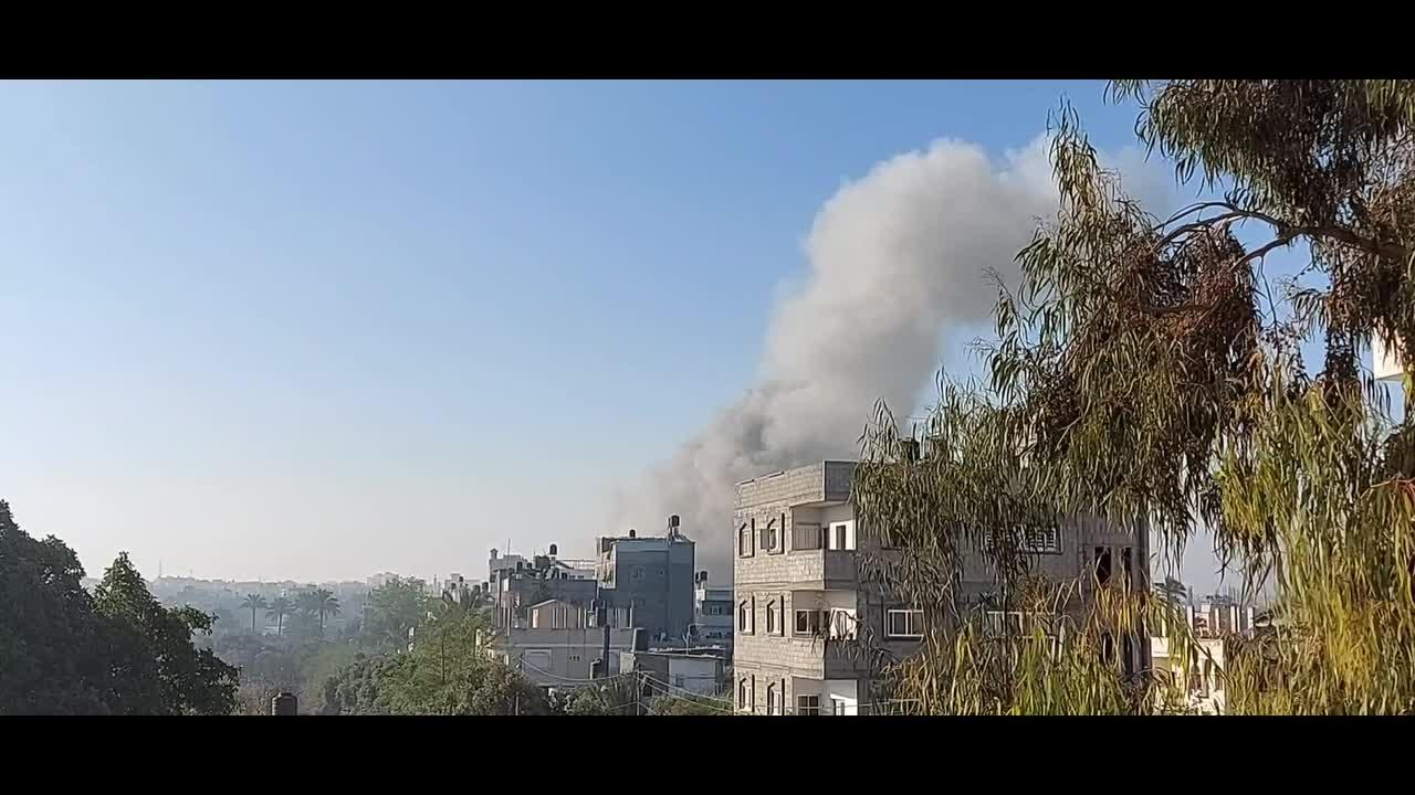 Smoke rises after Israeli air strikes on the Maghazi camp in central Gaza