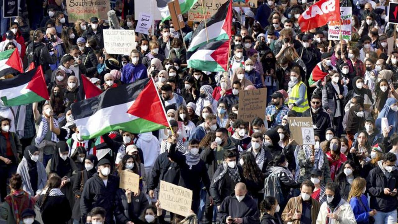 Clashes with police and Israeli TV reporter attacked at pro-Palestinian rally in Berlin
