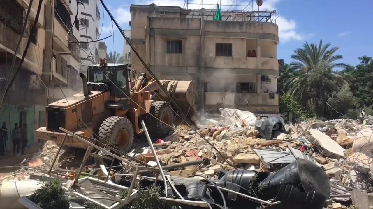 Excavators used in Gaza to clear huge mounds of rubble created by airstrikes