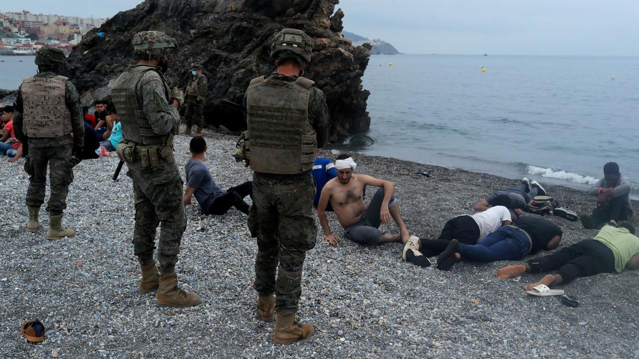 Spain returns people who swam from Morocco, adds troops to border
