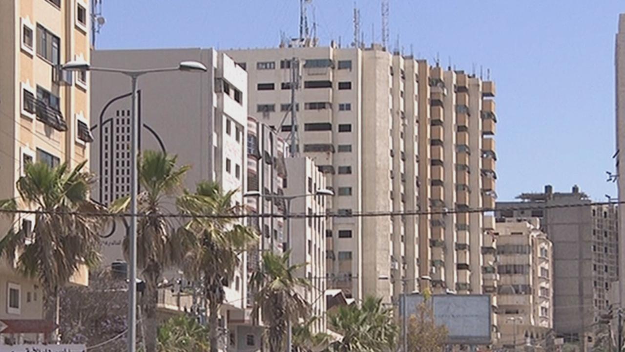 Dozens of Palestinian families evacuate tower block under threat