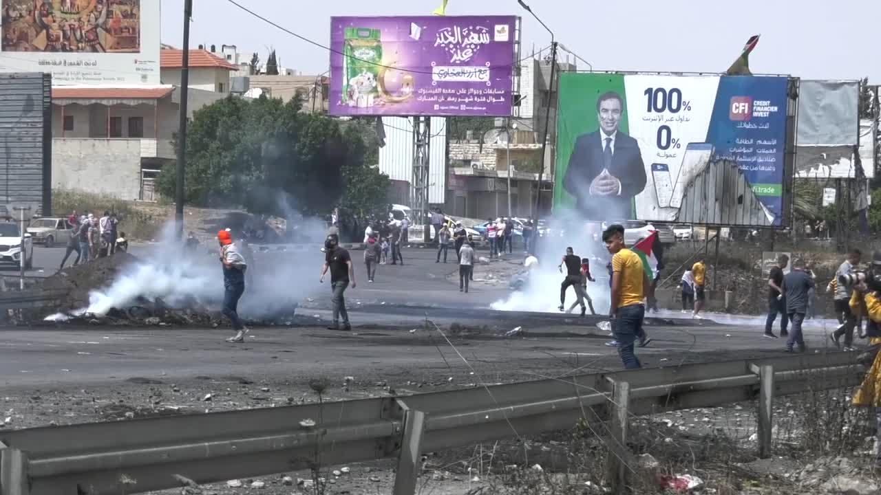 Palestinian protesters clash with Israeli forces in the occupied West Bank