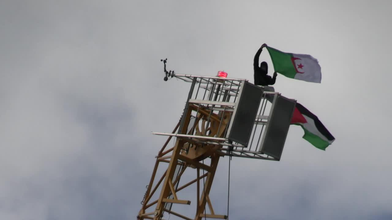 Protester climbs crane at Marble Arch during Free Palestine rally in London