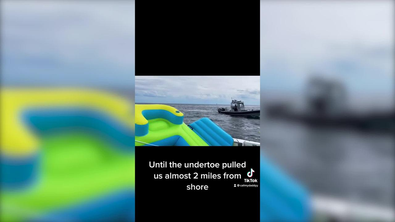 Couple who used inflatable float get rescued after getting stuck TWO MILES from the beach