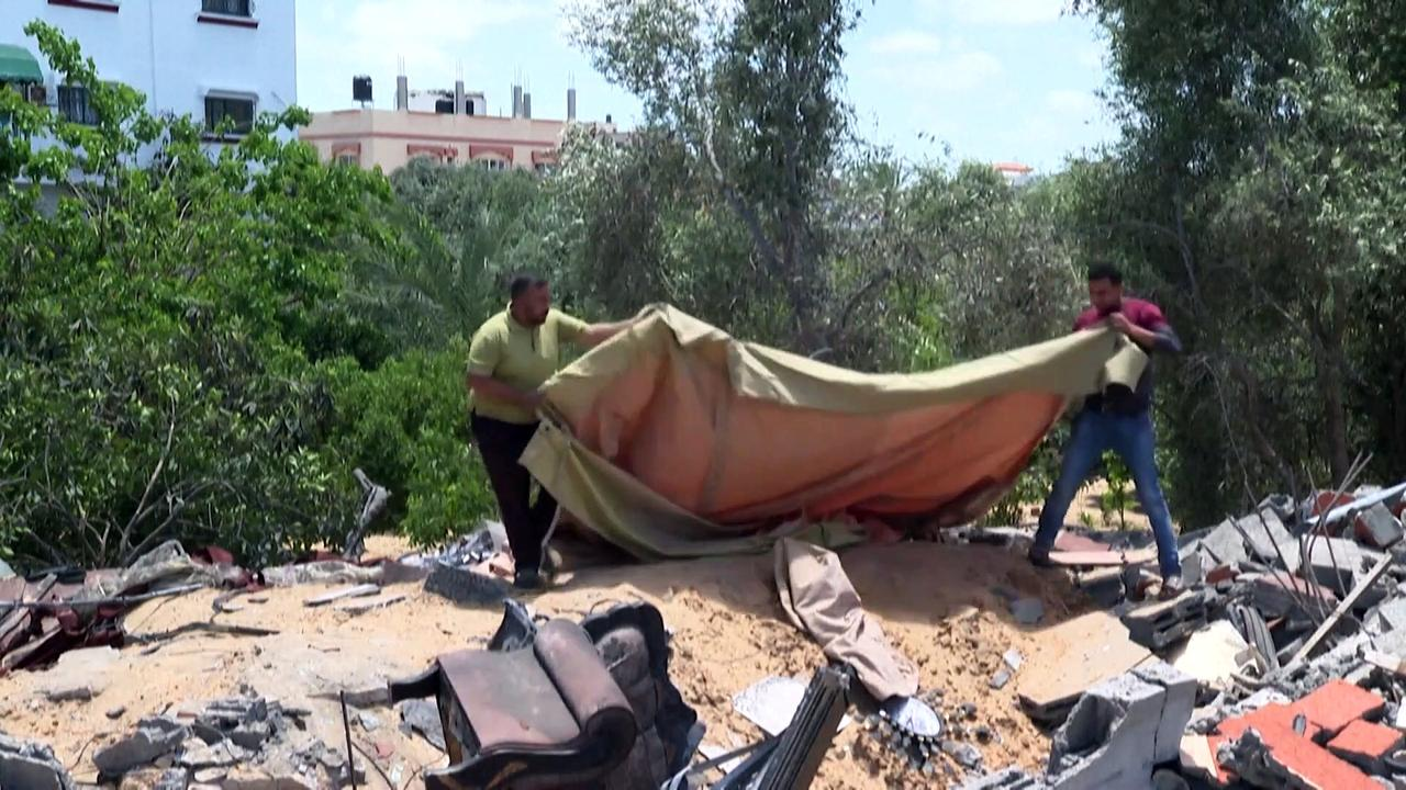 Palestinian sets up tent over house destroyed by Israeli air strike