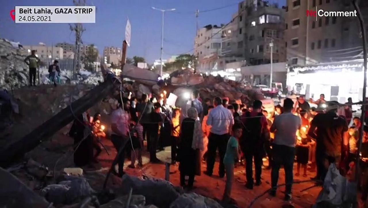 Palestinian children light candles during rally in northern Gaza