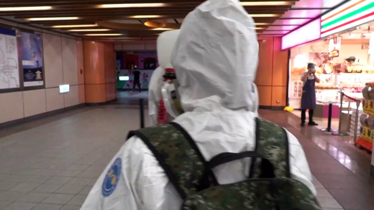 Taiwan extends lockdown, as soldiers disinfect metro and businesses shutter