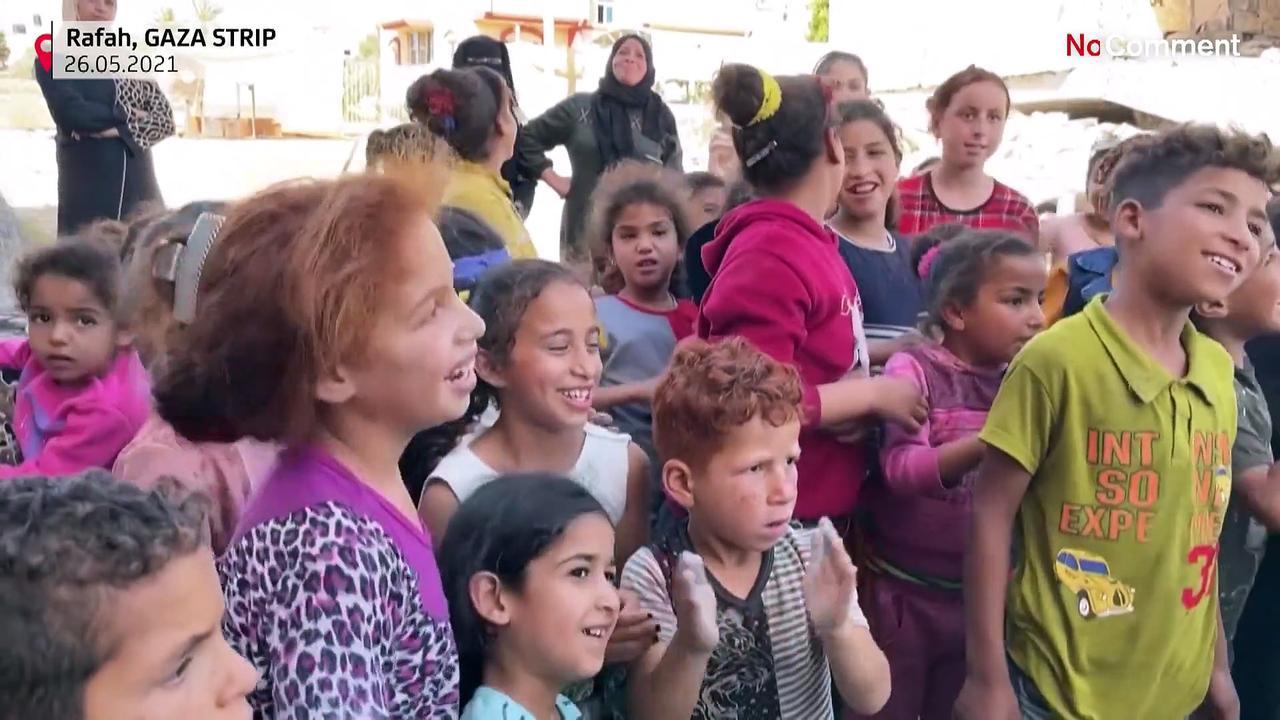 Palestinians dressed as clowns entertain children in Gaza
