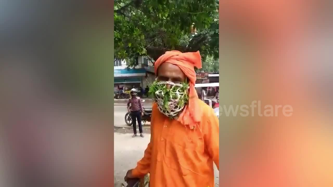 Indian man wears face mask made from leaves believing it will protect him from Covid-19