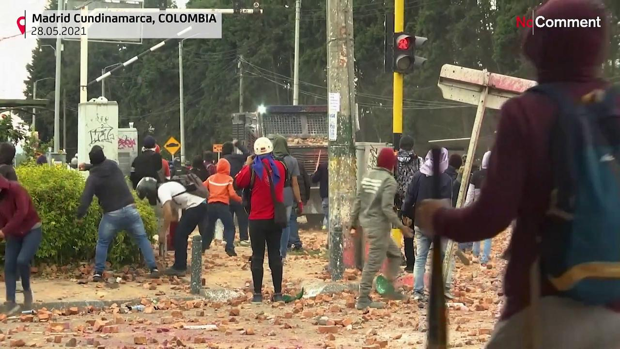 Police and protesters clash as Colombia's Duque deploys military