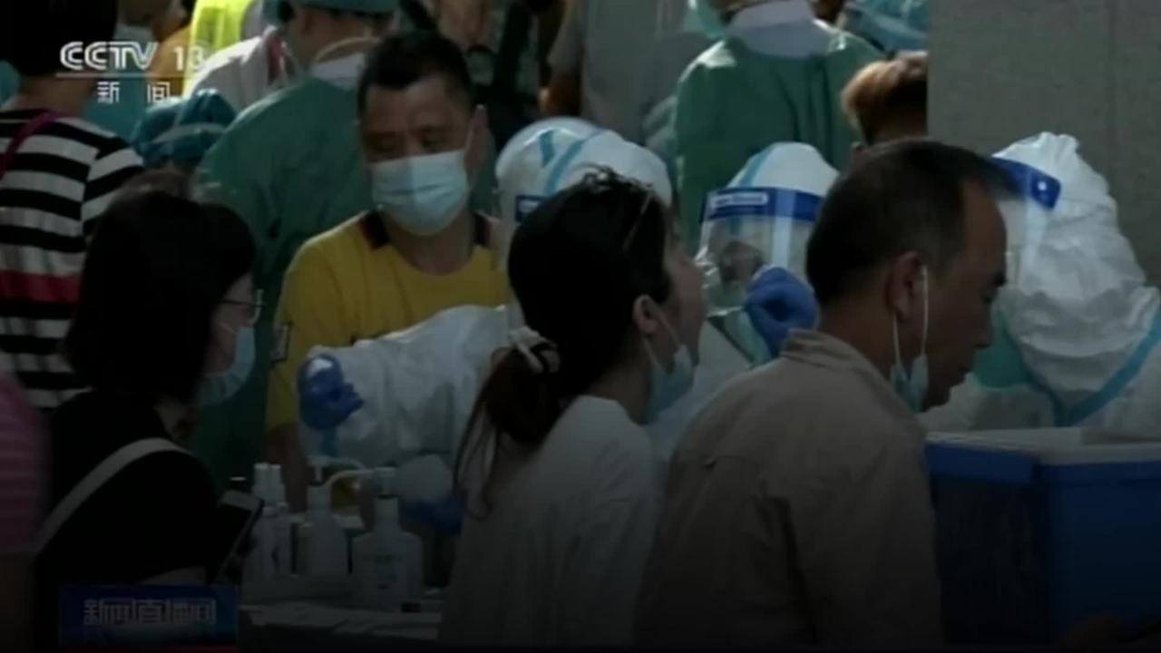 Chinese city locks down neighbourhood amid virus surge