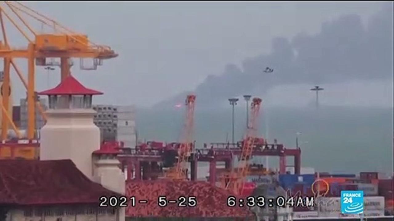 Burnt-out ship 'going down' off Sri Lanka coast