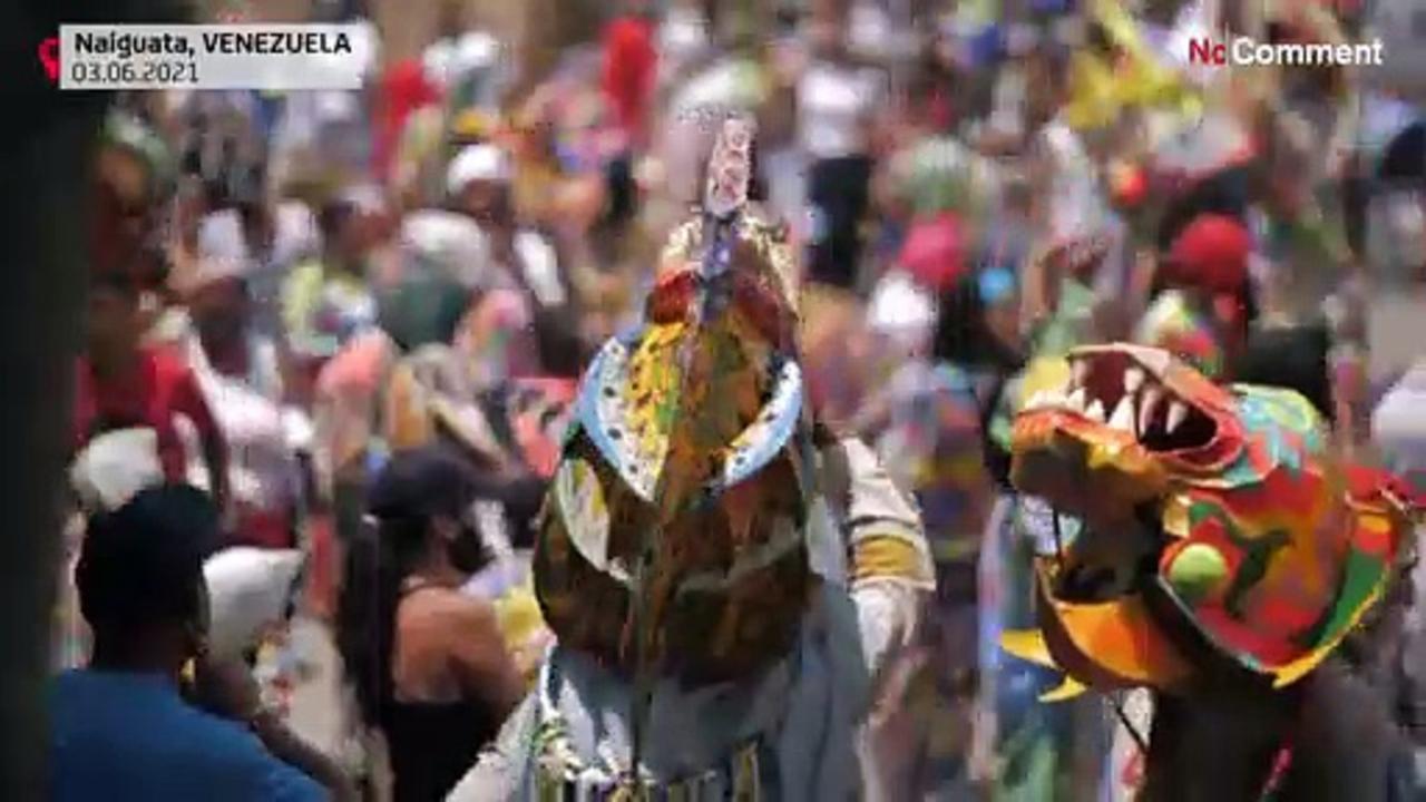 'Devils' dance, praying to end crisis in Venezuela